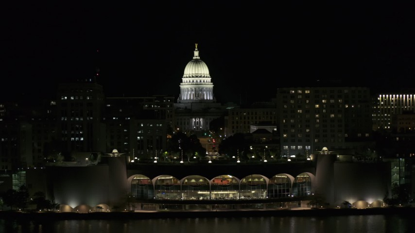 5.7K stock footage aerial video a view of the capital dome at night, reveal convention center, Madison, Wisconsin Aerial Stock Footage | DX0002_162_046