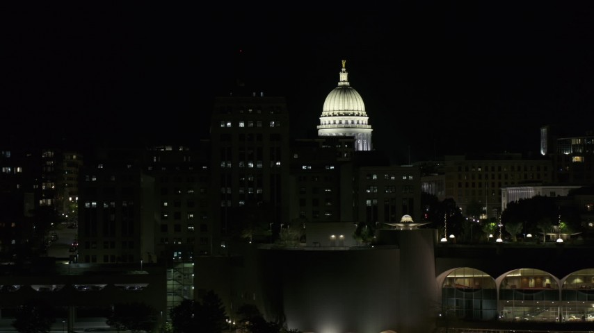 5.7K stock footage aerial video flyby State Office Building to reveal capital dome at night, Madison, Wisconsin Aerial Stock Footage | DX0002_162_047