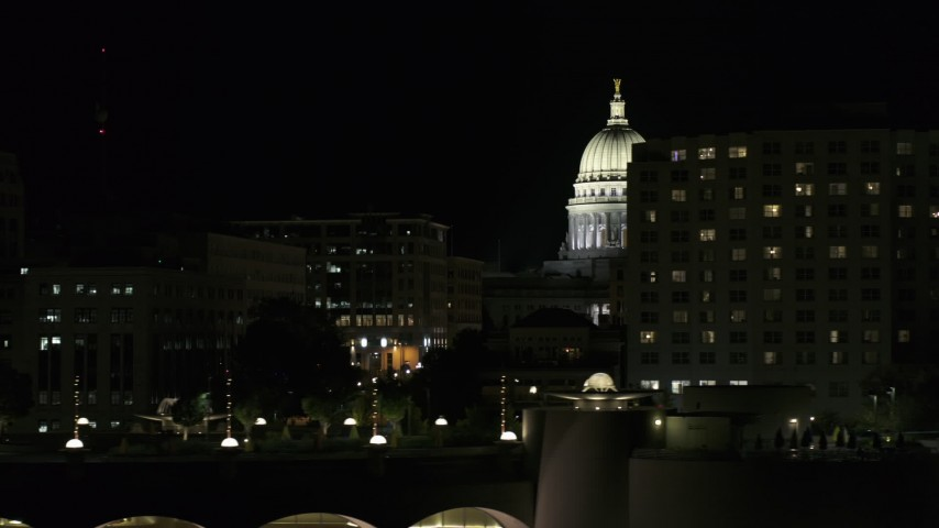 5.7K stock footage aerial video of the capital dome at night while flying by hotel, Madison, Wisconsin Aerial Stock Footage | DX0002_162_048
