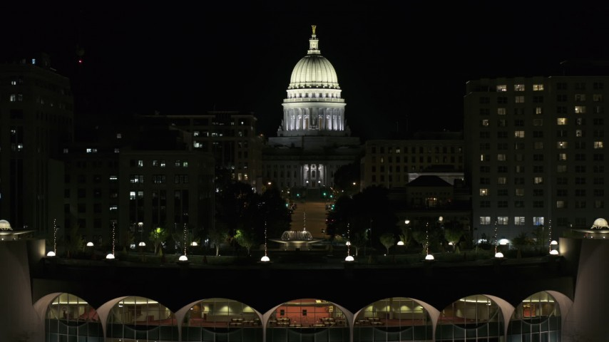 5.7K stock footage aerial video focus on the capital at night, descend to reveal convention center, Madison, Wisconsin Aerial Stock Footage | DX0002_162_049