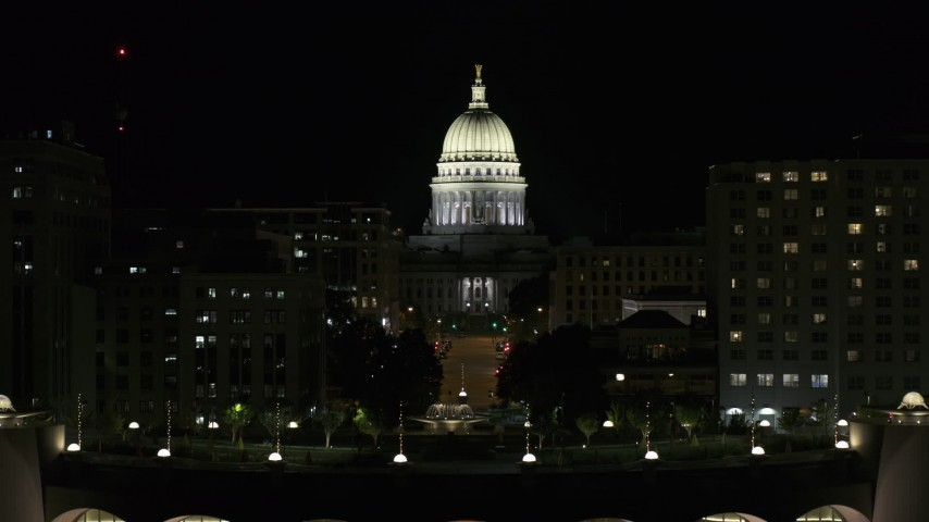 5.7K stock footage aerial video focus on the capital at night, ascend from convention center, Madison, Wisconsin Aerial Stock Footage   DX0002_162_050