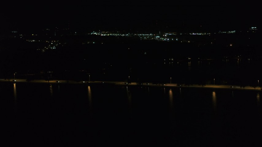 5.7K stock footage aerial video of light traffic on a causeway on the lake at night, Madison, Wisconsin Aerial Stock Footage | DX0002_162_056