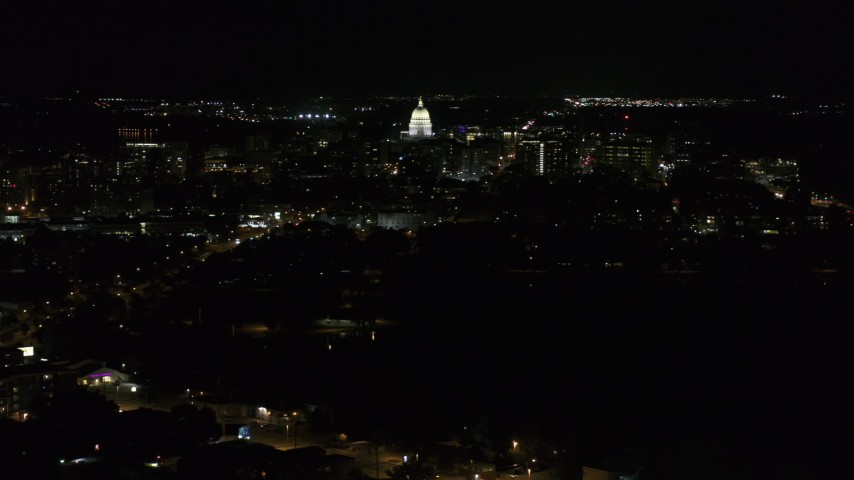 5.7K stock footage aerial video wide orbit of Wisconsin State Capitol and downtown buildings at night, Madison, Wisconsin Aerial Stock Footage | DX0002_163_007