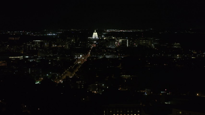 5.7K stock footage aerial video of Wisconsin State Capitol at the end of Washington Ave at night, Madison, Wisconsin Aerial Stock Footage | DX0002_163_010