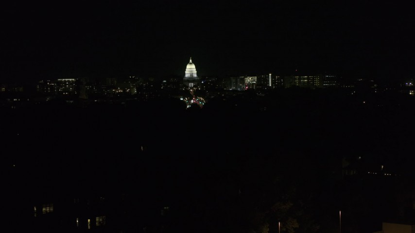 5.7K stock footage aerial video of a stationary view of the state capitol dome at night, Madison, Wisconsin Aerial Stock Footage | DX0002_163_013