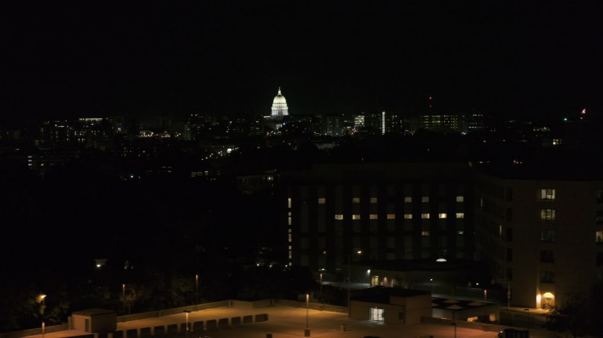 5.7K stock footage aerial video of the state capitol dome at night, seen from hospital, Madison, Wisconsin Aerial Stock Footage | DX0002_163_014