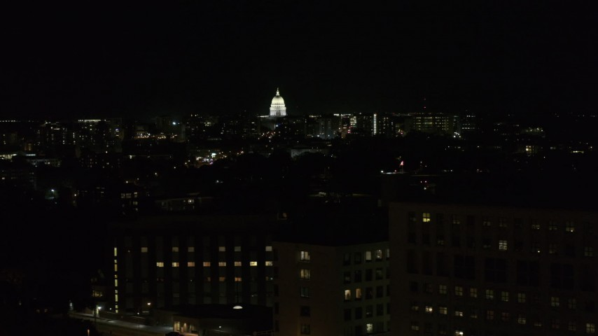 5.7K stock footage aerial video ascend by hospital at night while focused on capitol, Madison, Wisconsin Aerial Stock Footage | DX0002_163_015