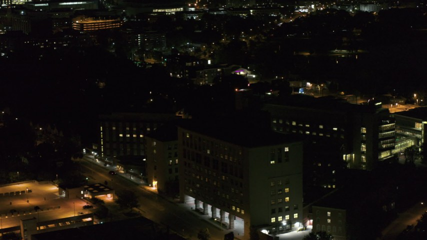 5.7K stock footage aerial video orbit a hospital complex and flyby parking garage at night, Madison, Wisconsin Aerial Stock Footage | DX0002_163_020