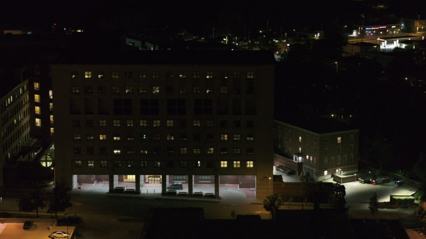 5.7K stock footage aerial video descend by a hospital complex at night, Madison, Wisconsin Aerial Stock Footage | DX0002_163_023