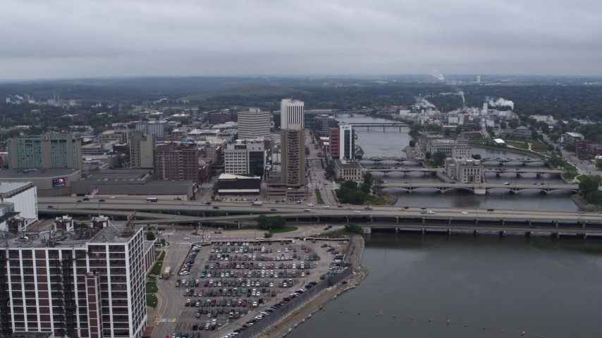 5.7K stock footage aerial video slow approach to apartment high-rise and office buildings near bridges and river, Downtown Cedar Rapids, Iowa Aerial Stock Footage | DX0002_164_003