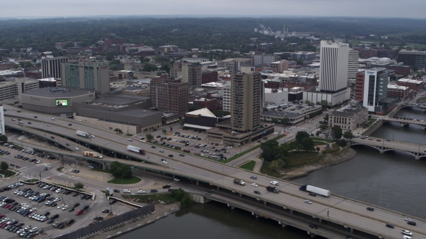 5.7K stock footage aerial video fly away from convention center, city buildings near river, Downtown Cedar Rapids, Iowa Aerial Stock Footage | DX0002_164_005