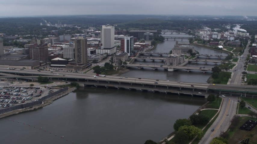5.7K stock footage aerial video a reverse view of bridges spanning the river by Downtown Cedar Rapids, Iowa Aerial Stock Footage | DX0002_164_006