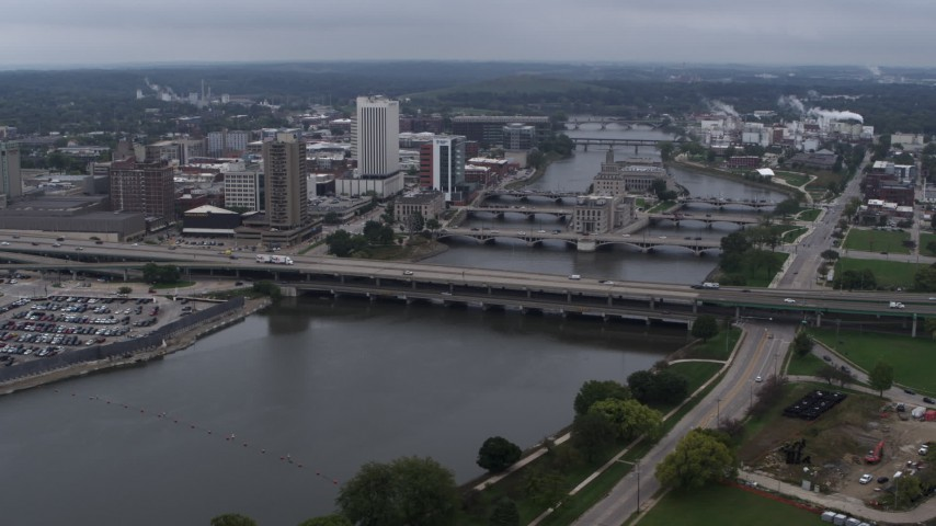 5.7K stock footage aerial video of flying by bridges spanning the river by Downtown Cedar Rapids, Iowa Aerial Stock Footage | DX0002_164_007