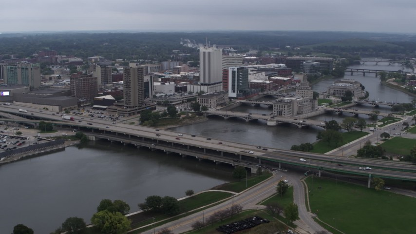 5.7K stock footage aerial video approach and flyby bridges spanning the river beside Downtown Cedar Rapids, Iowa Aerial Stock Footage | DX0002_164_008