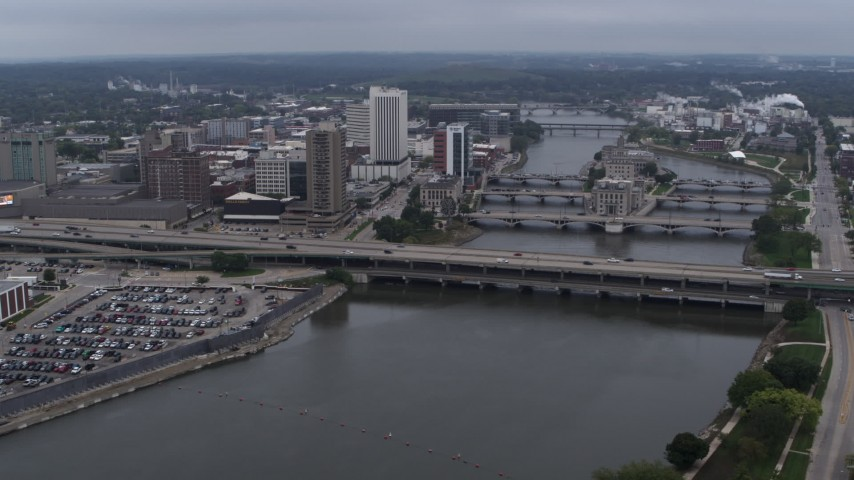 5.7K stock footage aerial video fly away from and flyby bridges spanning the river beside Downtown Cedar Rapids, Iowa Aerial Stock Footage | DX0002_164_009