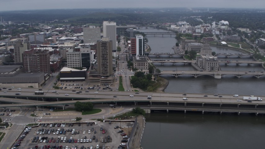 5.7K stock footage aerial video approach apartment high-rise and bridges spanning the river, Downtown Cedar Rapids, Iowa Aerial Stock Footage | DX0002_164_010