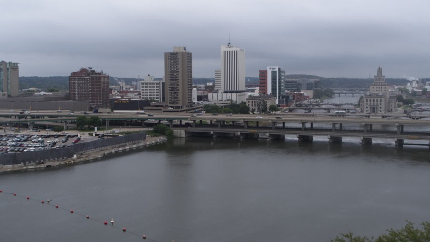 5.7K stock footage aerial video view of apartment high-rise and bridges spanning the river during descent, Downtown Cedar Rapids, Iowa Aerial Stock Footage | DX0002_164_013