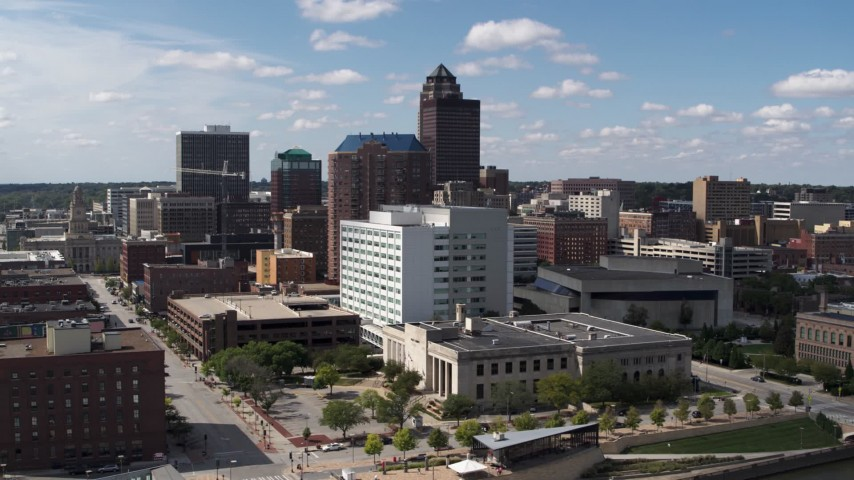 5.7K stock footage aerial video the city's skyline seen while passing office buildings in Downtown Des Moines, Iowa Aerial Stock Footage | DX0002_165_002