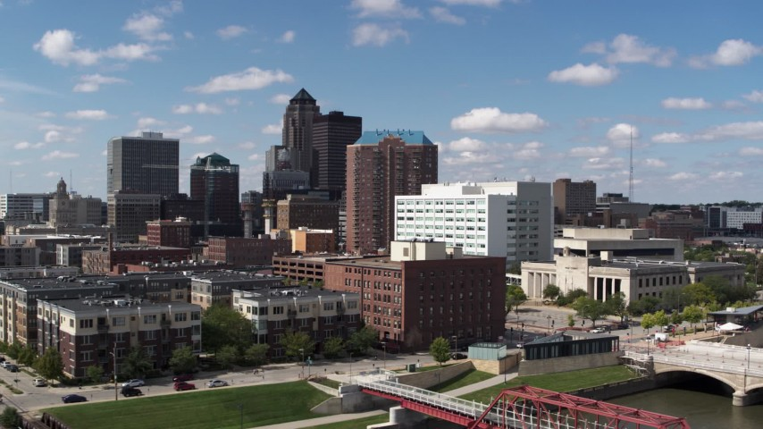 5.7K stock footage aerial video the city's skyline seen while passing apartment and office buildings in Downtown Des Moines, Iowa Aerial Stock Footage | DX0002_165_004