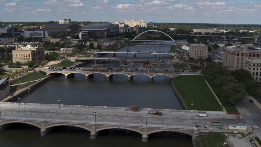 5.7K stock footage aerial video flyby and away from three bridges spanning the river in Des Moines, Iowa Aerial Stock Footage | DX0002_165_010