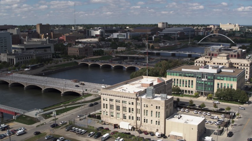 5.7K stock footage aerial video approach bridges spanning the river in Des Moines, Iowa Aerial Stock Footage | DX0002_165_012
