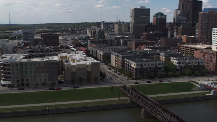 5.7K stock footage aerial video orbit hotels and apartment complex, reveal skyline of Downtown Des Moines, Iowa Aerial Stock Footage | DX0002_165_013