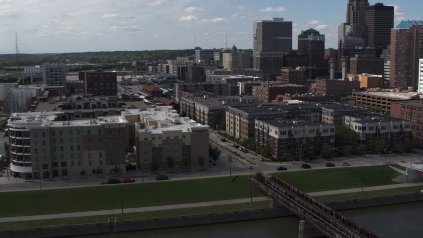 5.7K stock footage aerial video orbit hotels and apartment complex near the skyline of Downtown Des Moines, Iowa Aerial Stock Footage | DX0002_165_014