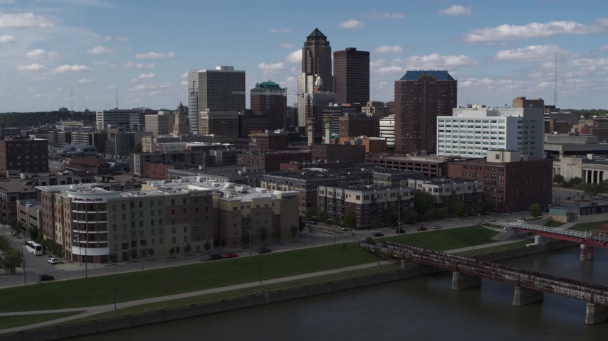 5.7K stock footage aerial video slow orbit of hotels and apartment complex, reveal skyline of Downtown Des Moines, Iowa Aerial Stock Footage | DX0002_165_015