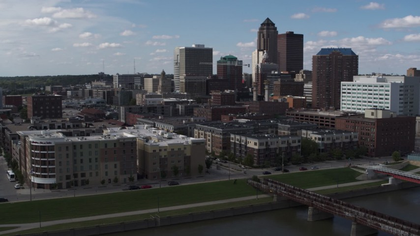 5.7K stock footage aerial video an orbit of hotels and apartment complex, reveal train tracks, Downtown Des Moines, Iowa Aerial Stock Footage | DX0002_165_016