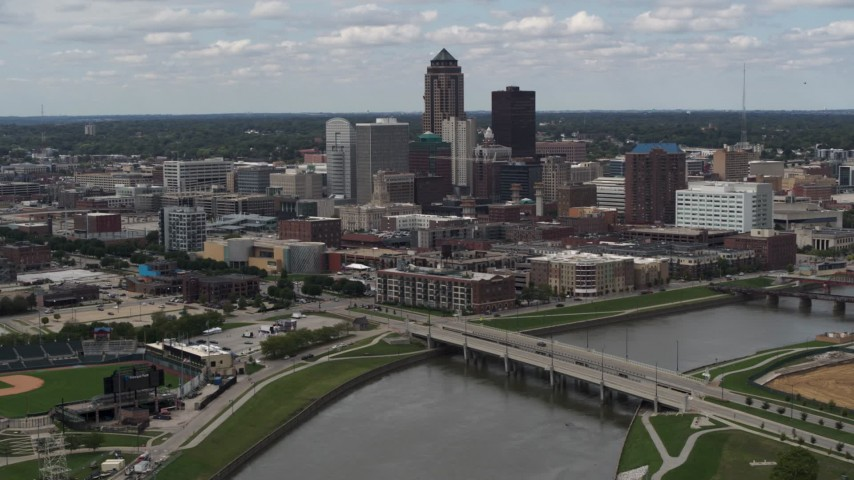 5.7K stock footage aerial video a reverse view of skyline across the river, Downtown Des Moines, Iowa Aerial Stock Footage | DX0002_165_019