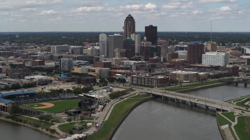 5.7K stock footage aerial video a slow approach to the city's skyline across the river, Downtown Des Moines, Iowa Aerial Stock Footage | DX0002_165_020