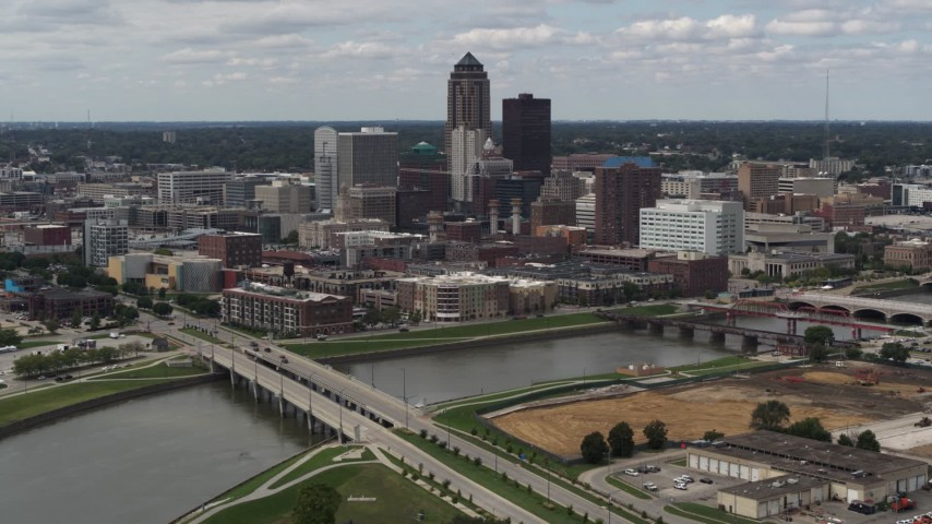 5.7K stock footage aerial video fly away from the city's skyline and bridges over the river, Downtown Des Moines, Iowa Aerial Stock Footage | DX0002_165_022