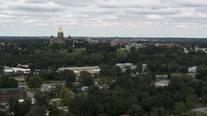 5.7K stock footage aerial video of passing by and the approaching the Iowa State Capitol and grounds in Des Moines, Iowa Aerial Stock Footage | DX0002_165_025