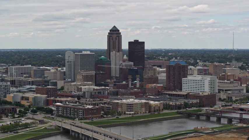 5.7K stock footage aerial video of flying by the Cedar River while focused on skyline of Downtown Des Moines, Iowa Aerial Stock Footage | DX0002_165_031