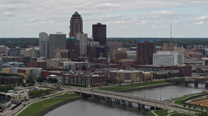 5.7K stock footage aerial video of flying by a Cedar River bridge with view of skyline, Downtown Des Moines, Iowa Aerial Stock Footage | DX0002_165_034