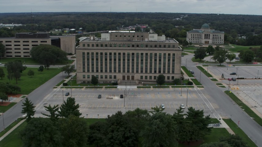 5.7K stock footage aerial video orbit and fly away from a state government office building, Des Moines, Iowa Aerial Stock Footage | DX0002_166_031