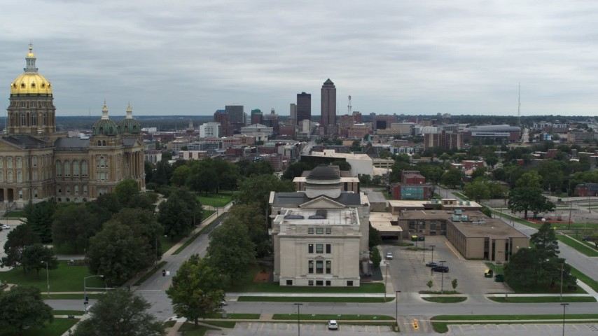 5.7K stock footage aerial video the distant skyline seen from the state library building and Iowa State Capitol, Downtown Des Moines, Iowa Aerial Stock Footage | DX0002_166_033