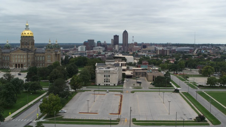 5.7K stock footage aerial video reverse view of distant skyline seen from the state library and capitol, Downtown Des Moines, Iowa Aerial Stock Footage | DX0002_166_034
