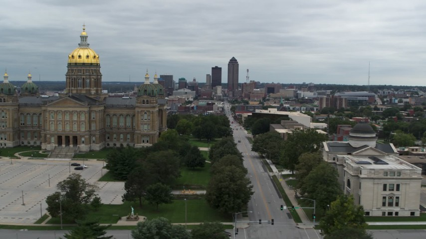 5.7K stock footage aerial video view of distant skyline, approach state library and pass capitol, Downtown Des Moines, Iowa Aerial Stock Footage | DX0002_166_035