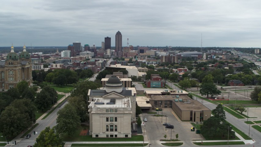 5.7K stock footage aerial video of the distant skyline seen while descending by state library building, Des Moines, Iowa Aerial Stock Footage | DX0002_166_041