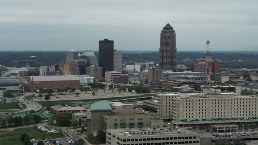 5.7K stock footage aerial video of a reverse view of the city's skyline and skyscraper in Downtown Des Moines, Iowa, reveal hospital Aerial Stock Footage | DX0002_167_003