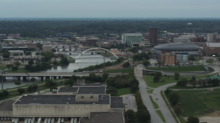 5.7K stock footage aerial video of bridges over Cedar River by the arena in Downtown Des Moines, Iowa Aerial Stock Footage | DX0002_167_011