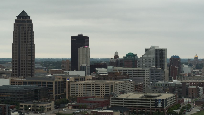 5.7K stock footage aerial video of flying by a towering skyscraper and office buildings in Downtown Des Moines, Iowa Aerial Stock Footage | DX0002_167_015