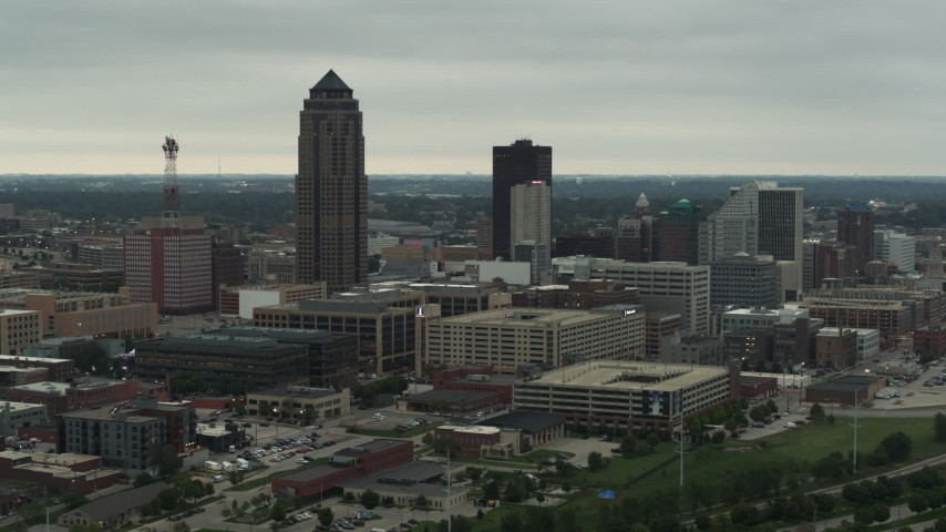 5.7K stock footage aerial video flying by a towering skyscraper and office buildings in Downtown Des Moines, Iowa Aerial Stock Footage | DX0002_167_018