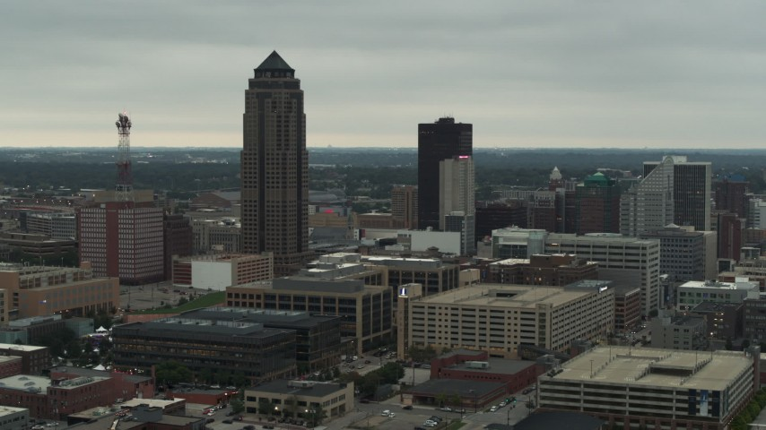 5.7K stock footage aerial video passing by a towering skyscraper and office buildings in Downtown Des Moines, Iowa Aerial Stock Footage | DX0002_167_019