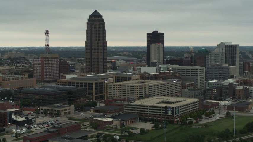 5.7K stock footage aerial video focus on a towering skyscraper and office buildings in Downtown Des Moines, Iowa Aerial Stock Footage | DX0002_167_020