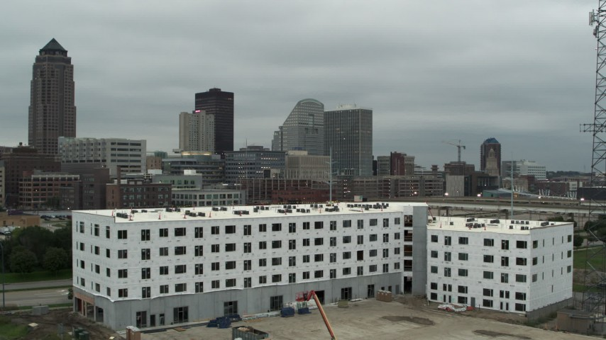 5.7K stock footage aerial video office buildings near the skyscraper in Downtown Des Moines, Iowa, seen from construction Aerial Stock Footage | DX0002_167_030