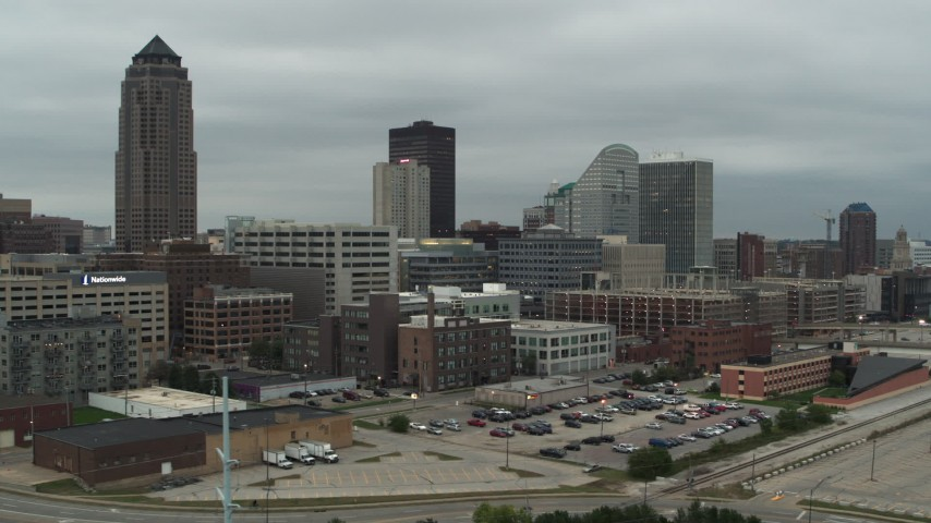 5.7K stock footage aerial video fly away from office buildings and a skyscraper in Downtown Des Moines, Iowa Aerial Stock Footage | DX0002_167_032