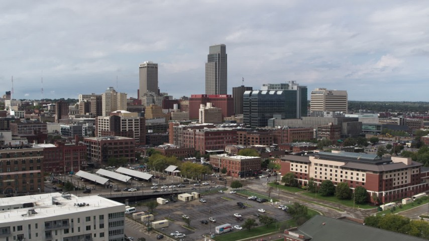 5.7K stock footage aerial video of a reverse view of the city's skyline in Downtown Omaha, Nebraska Aerial Stock Footage | DX0002_168_002