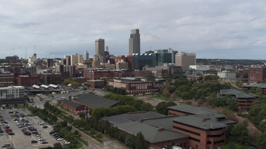 5.7K stock footage aerial video of flying away from the city's skyline in Downtown Omaha, Nebraska Aerial Stock Footage | DX0002_168_003